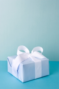 Gift box on blue with copy space